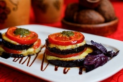 Baked eggplant with tomato and suluguni